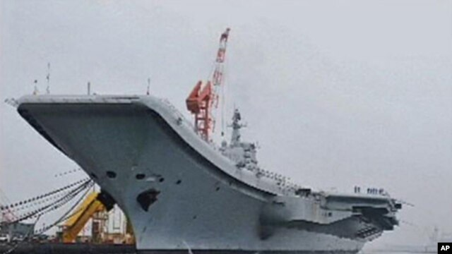 China's first aircraft carrier is seen at its shipyard at Dalian Port in northeast China's Liaoning province, in this still image taken from a July 27, 2011