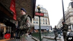 FILE - French soldiers patrol in Paris as part of heightened security following a deadly terrorist attack at satirical newspaper in January 2015.