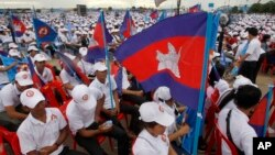 In this July 7, 2018, file photo, supporters wait for the start of a campaign rally of Cambodian Prime Minister Hun Sen's Cambodian People's Party in Phnom Penh, Cambodia. (AP Photo/Heng Sinith, File)