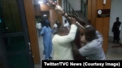 Intruders seize the symbol of authority of the upper house of Parliament, the mace, in the Senate, Nigeria, April 18, 2018. (Twitter/TVC News)