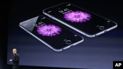 FILE - In this March 9, 2015, file photo, Apple CEO Tim Cook talks about the iPhone 6 and iPhone 6 Plus during an Apple event in San Francisco. Apple is apologizing for secretly slowing down older iPhones, which it says was necessary to avoid unexpected shutdowns related to battery fatigue.