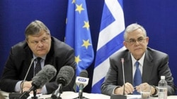 Greek Prime Minister Lucas Papademos, right, and Finance Minister Evangelos Venizelos after a meeting of euro-area finance ministers in Brussels