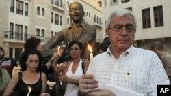 黎巴嫩活动人士7月31日在贝鲁特举行烛光守夜活动,支持叙利亚人民