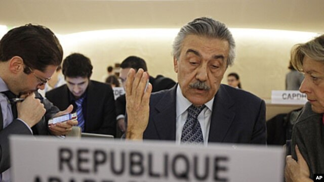 Syria's Ambassador Faysal Khabbaz Hamoui (C) gestures during a Human Rights Council special session on the situation in Syria at the United Nations in Geneva, December 2, 2011.