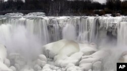 "The U.S. side of Niagara Falls has begun to thaw after being partially frozen from the recent ""polar vortex"" that affected millions in the U.S. and Canada, Friday, Jan. 10, 2014 in Niagara Falls, N.Y."