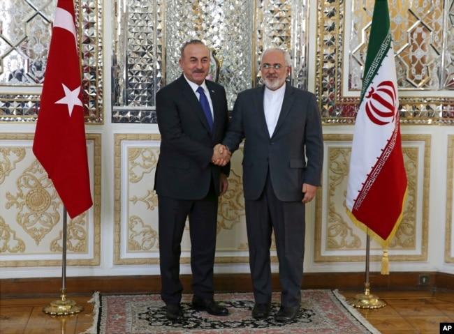 Türk ve İran dışişleri bakanları Mevlüt Çavuşoğlu ve Cevat Zarif