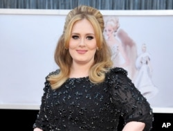 FILE - Adele arrives at the Oscars in Los Angeles.