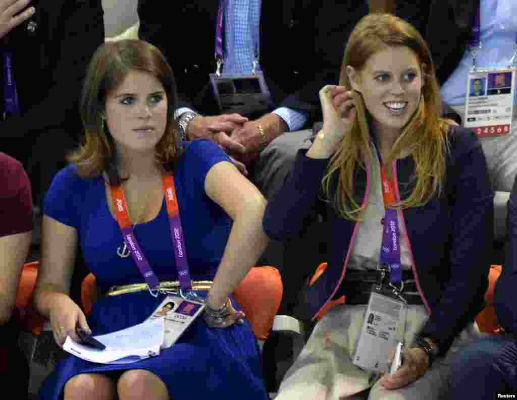 Britain's Princesses Eugenie (L) and Beatrice watch the swimming events during the London 2012 Olympic Games at the Aquatics Centre July 30, 2012.
