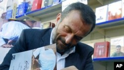 "Hazem al-Amin signs copies of his new book, ""The Lonely Salafist"" in Beirut. The book aims to prove that the loss of national identity among the Palestinian diaspora has been an important factor in shaping al-Qaida."