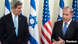 U.S. Secretary of State John Kerry listens as Israeli Prime Minister Benjamin Netanyahu makes a statement to the press before a meeting in Jerusalem on January 2, 2014.