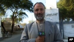 VOA reporter Mukarram Khan Aatif shown in northwest Pakistan in January 2012.