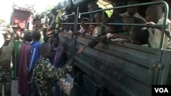 FILE - Nigerian refugees are seen on a Cameroonian military truck set to make its way out of Fotokol for Nigeria, in Fotokol, Cameroon, April 19, 2017. (M.E. Kindzeka/VOA)