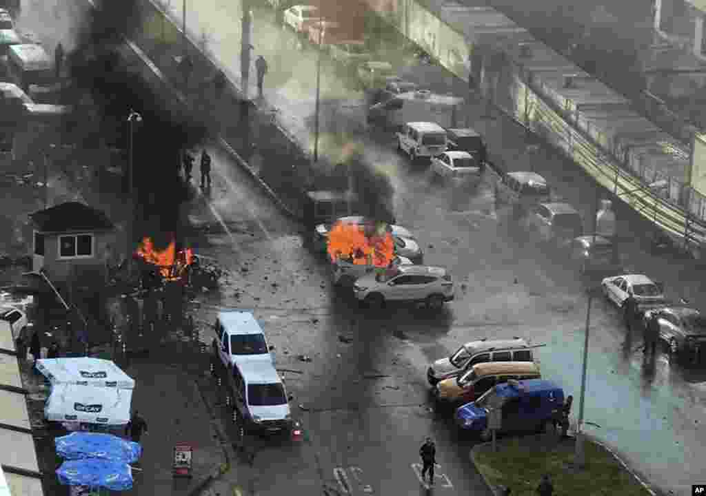 Cars burn after a car bomb explosion in Izmir, Turkey. An explosion believed to have been caused by a car bomb in front of a courthouse in the western Turkish city of Izmir, wounded several people, a local official said. Two of the suspected attackers were killed in an ensuing shootout with police.