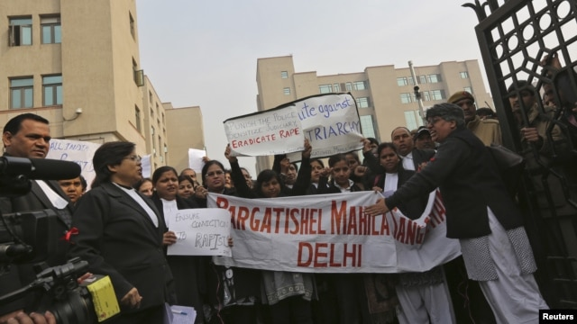 Lawyers shout slogans as they hold placards and a banner during a protest demanding the judicial system act faster against rape, outside a district court in New Delhi, India, January 3, 2013.