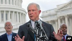 FILE - Sen. Jeff Sessions speaks at a news conference.