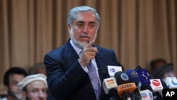 Afghanistan's presidential candidate Abdullah Abdullah speaks during a news conference in Kabul, Afghanistan, June 15, 2014.