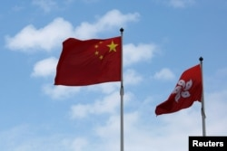 A Chinese national flag and a Hong Kong flag fly outside the Legislative Council in Hong Kong, China November 7, 2016, as China's parliament passed an interpretation of Hong Kong's Basic Law on Monday that says lawmakers must swear allegiance to the city