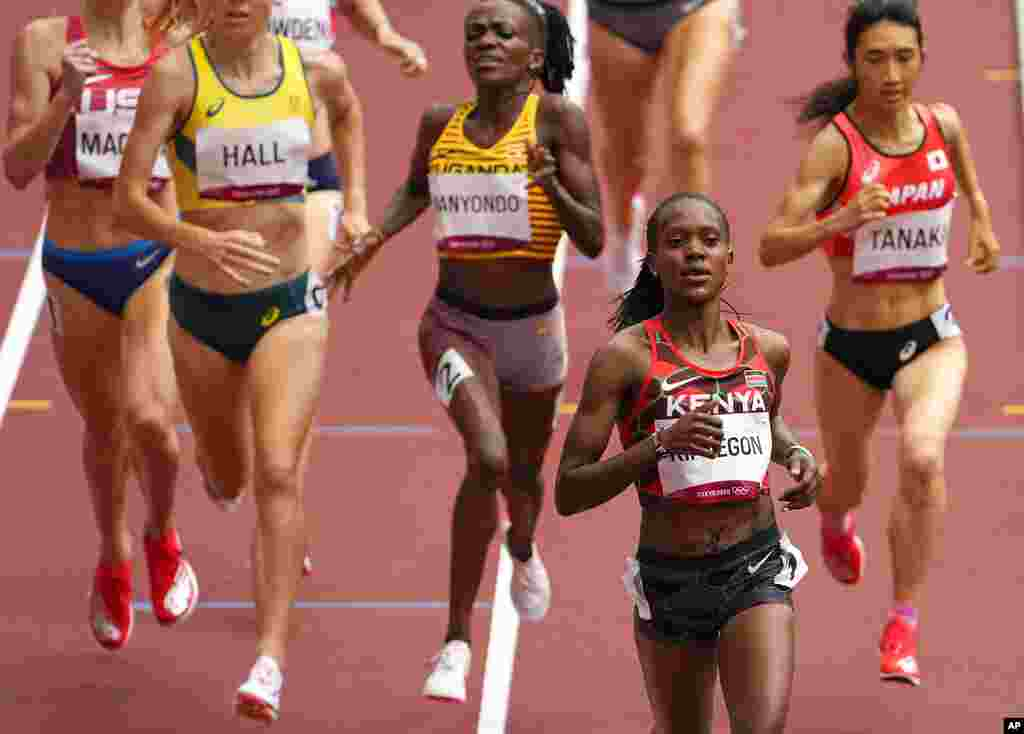 Faith Kipyegon, of Kenya races to win a women's 1,500-meter heat at the 2020 Summer Olympics, Monday, Aug. 2, 2021, in Tokyo, Japan. (AP Photo/Charlie Riedel)