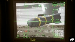 An unmanned aerial vehicle's Predator Hellfire missile is shown on a simulator's virtual camera.