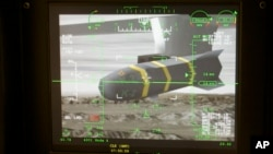 FILE - An unmanned aerial vehicle's Predator Hellfire missile is shown on a simulator's virtual camera.