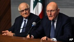 Lebanese Prime Minister Tammam Salam, right, speaks as Lebanese Information Minister Ramzi Jreij, left, listens during a press conference at the government House in Beirut, Lebanon, Feb. 22, 2016.