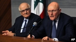 Lebanese Prime Minister Tammam Salam, right, speaks as Lebanese Information Minister Ramzi Jreij, left, listens during a press conference at the government House in Beirut, Lebanon, Feb. 22, 2016.