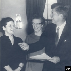 Nancy Grace Roman, center, with President John F. Kennedy in the Oval Office at the White House in 1962.