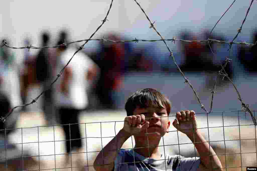 A child is seen at the new temporary camp for migrants and refugees, on the island of Lesbos, Greece.