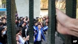 FILE - University students attend an anti-government protest at Iran's Tehran University, Dec. 30, 2017. The photo, obtained by the Associated Press, was taken by an individual not employed by AP.