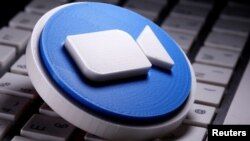 A 3D printed Zoom logo is placed on the keyboard in this illustration taken April 12, 2020. (REUTERS/Dado Ruvic/Illustration)