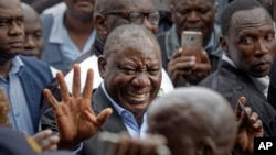 FILE - President Cyril Ramaphosa greets supporters after casting his vote at the Hitekani Primary School in Soweto, Johannesburg, South Africa, May 8, 2019.