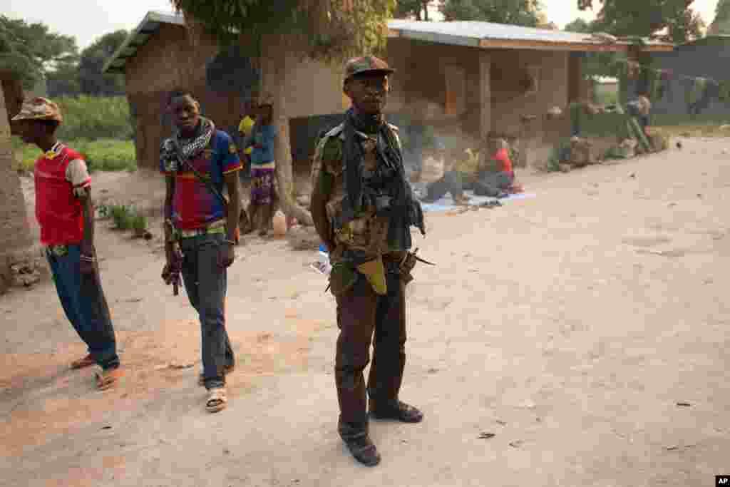 Militiamen stand in one of their bases near Mpoko Airport in Bangui, Jan. 9, 2014.