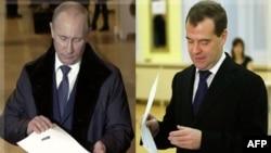 Bosh vazir Vladimir Putin va Prezident Dmitriy Medvedev saylov uchastkalarida. 4-dekabr 2011-yil, Moskva