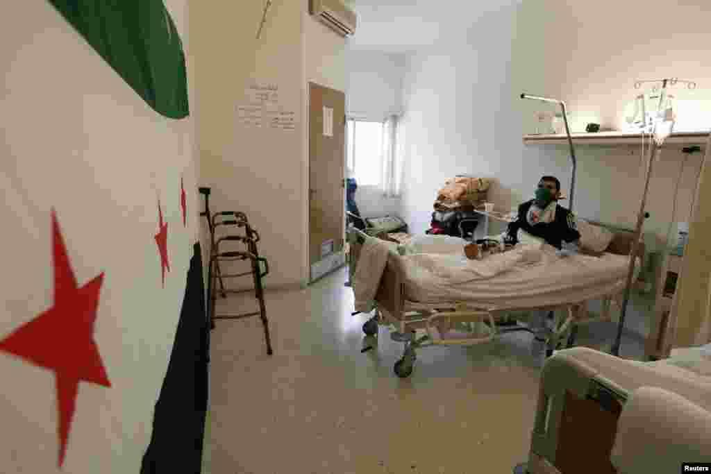 Suriyada jarohat olgan faol Livandagi kasalxonada davolanmoqda, 12-aprel, 2012-yil.