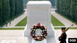A Soldier with the 3rd Infantry Regiment guards the Tomb of the Unknown Soldier at Arlington National Cemetery.