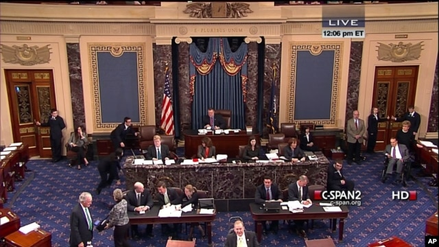 This handout video image shows former Senate Majority Leader Bob Dole, right, in the Senate Chamber on Capitol Hill, Dec. 4,2012, by his wife Elizabeth Dole. Frail and in a wheelchair, Dole was a startling presence on the Senate floor as lawmakers voted on a treaty on disabilities.