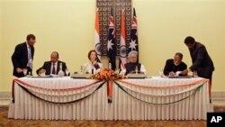 澳大利亞總理吉拉德和印度總理辛格同意開始就一項民用核項目合作協議進行談判