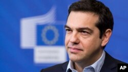 FILE - Greece's Prime Minister Alexis Tsipras addresses the media at the European Commission headquarters in Brussels, March 13, 2015.