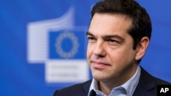 Greece's Prime Minister Alexis Tsipras addresses the media at the European Commission headquarters in Brussels, March 13, 2015.
