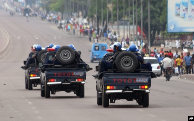 Congo riot police patrol streets on trucks, after violence erupted due to the delay of the presidential elections in Kinshasa, Democratic Republic of Congo, Sept. 20, 2016.