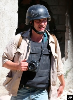 Photographer Andrei Stenin is shown working near Damascus in this 2013 provided by Syria's ITAR-TASS.