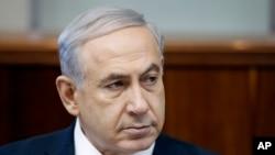 Perdana Menteri Israel Benjamin Netanyahu menghadiri rapat kabinet mingguan di Yerusalem, Minggu, 22 Juni 2014.