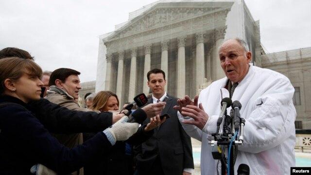 Indiana soybean farmer Vernon Bowman speaks to the media outside the Supreme Court in Washington, Feb. 19, 2013.
