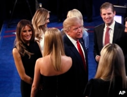 Donald Trump talks to his family after debate.
