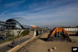 Homeless tents are pitched on the Santa Ana River trail near the Anaheim Regional Transportation Intermodal Center, a $185-million transportation center, in Anaheim, California, Dec. 2, 2017.