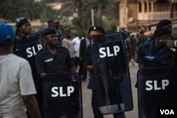Police hold shields following running battles with supporters of the opposition Sierra Leone People's Party in the Goderich neighborhood of Freetown, Sierra Leone, March 7, 2018. (J. Patinkin/VOA)