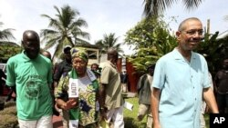 Liberian President and presidential candidate of the Unity Party (UP) Ellen Johnson-Sirleaf walks at her residence in Monrovia October 7, 2011.