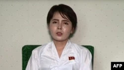 This undated screen grab taken on July 19, 2017, from video posted by www.uriminzokkiri.com shows North Korean defector Lim Ji-Hyun, who appeared in several South Korean TV shows featuring North Korean refugees after settling in Seoul in 2014, speaking on North Korean propaganda television at an unknown location in the North.