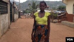 Isatu Gbankay, six months pregnant, stands outside a friend's home in Freetown, Sierra Leone, April 8, 2015. (Nina deVries/VOA)