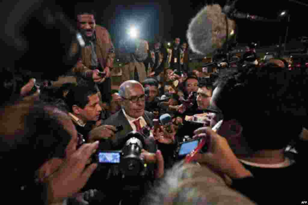 Former Director General of the International Atomic Energy Agency, IAEA, and Nobel Peace Prize winner Mohamed ElBaradei talks to members of the media as he arrives at Cairo's airport in Egypt, from Austria, Thursday, Jan. 27, 2011. ElBaradei told reporter